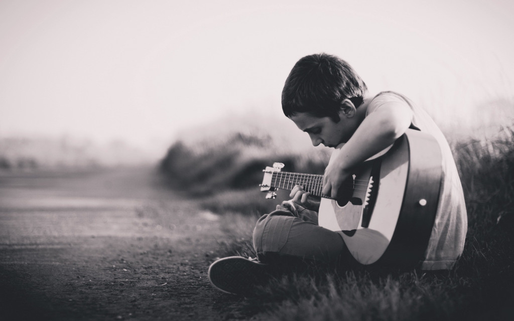 Lonely-Boy-Playing-Guitar-HD-Wallpapers-1024x640